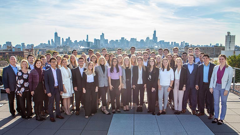 A photo of the students and staff in the Global Sales Workshop with the skyline of Chicago in the background