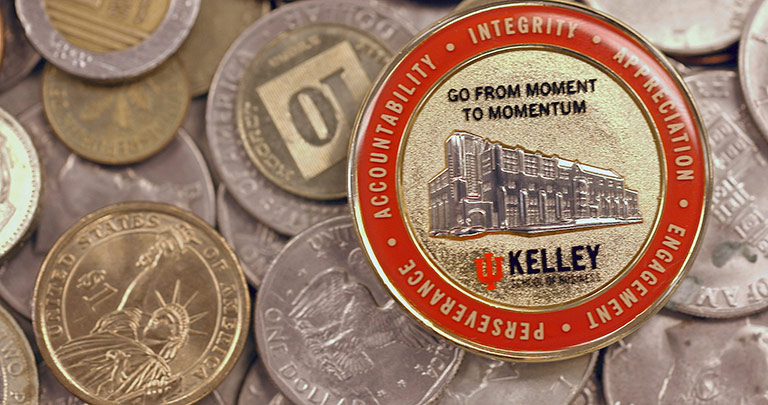 The Kelley coin on a pile of coins.