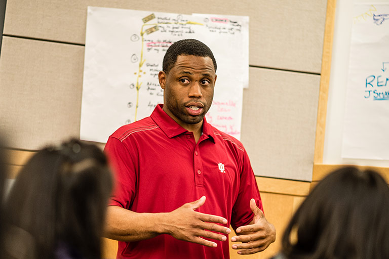 An MBA student presents his Me., Inc. story to classmates