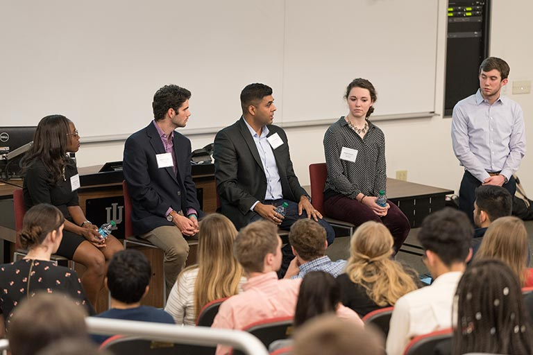 Members of the Kelley Student Government talk with a Kelley alum