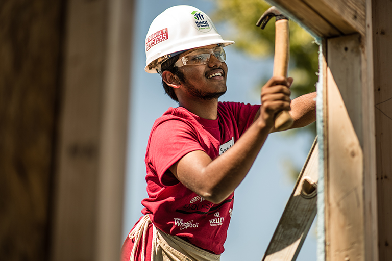 Student working at a Habitat for Humanity build site